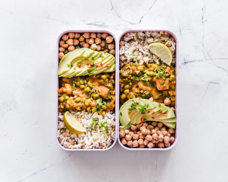 Picture of a packed lunch with rice and vegetables and legumes