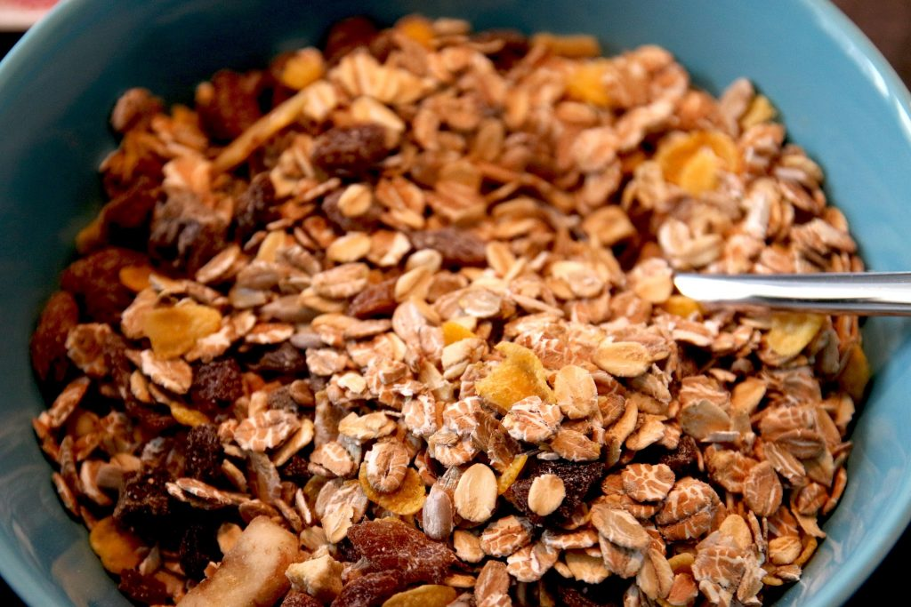 Bowl of cereal with oats, nuts and dried fruit.