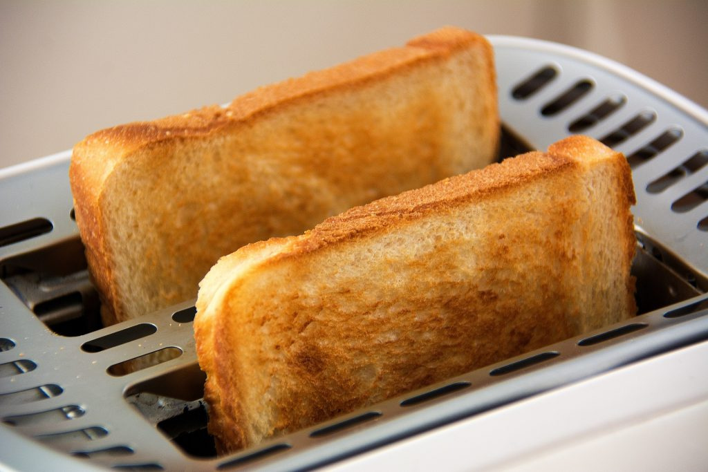 Toast popping out of a toaster.