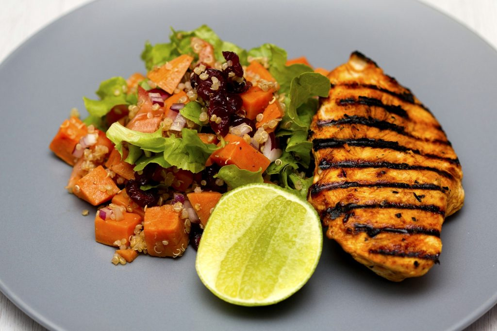 Grilled chicken with lime and quinoa sweet potato salad.