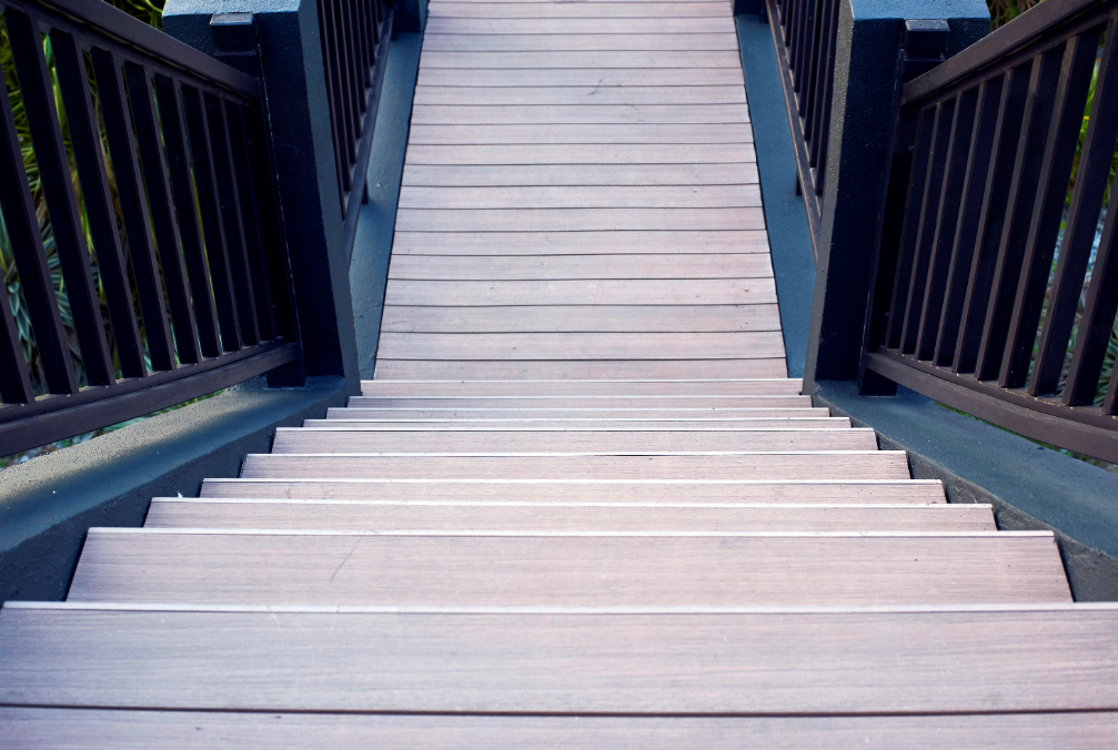 Looking down wooden steps leading outdoors.