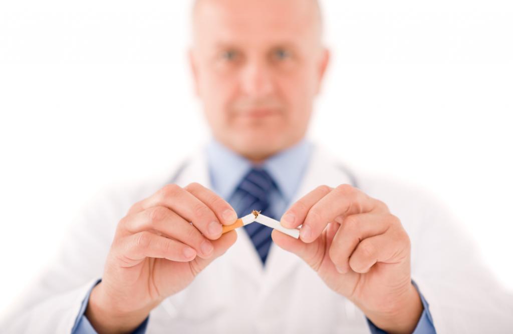 Doctor breaking a cigarette in half.