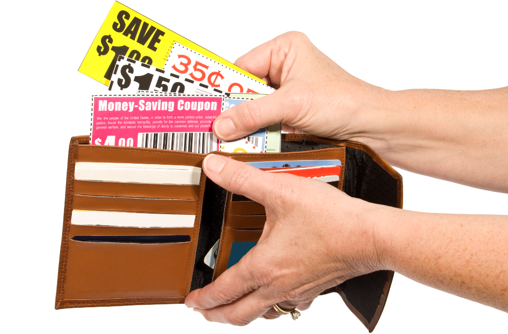 Woman holding wallet open to put coupons in.