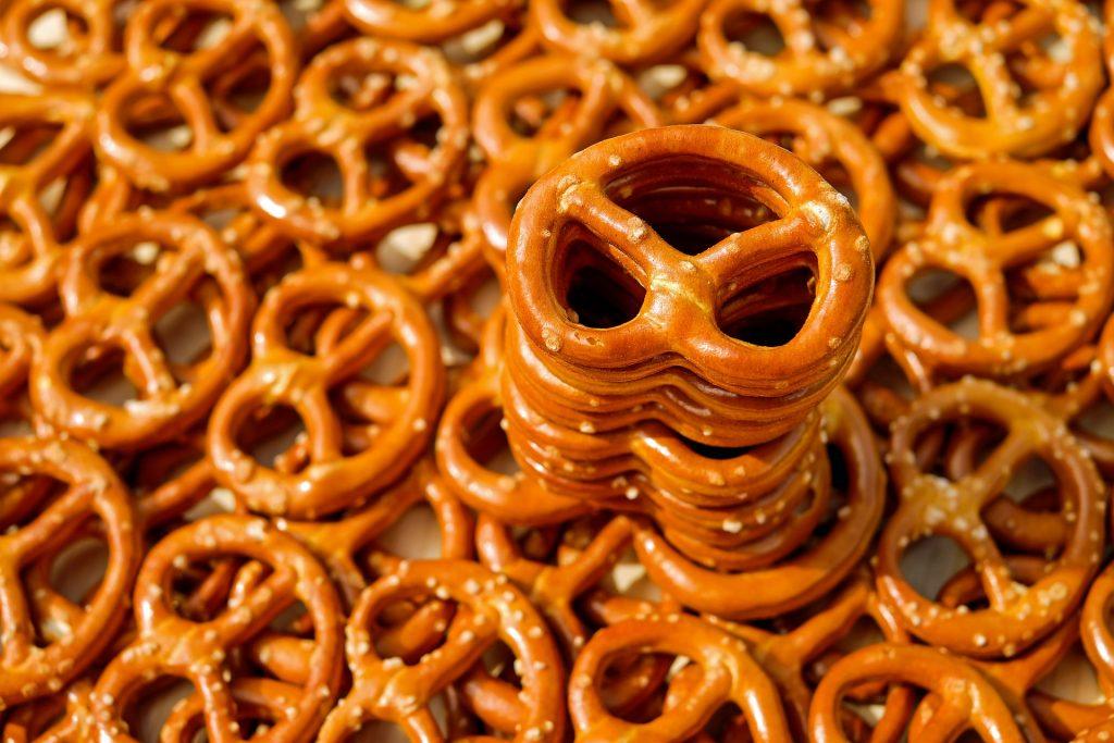 Stack of pretzels on top of plate of pretzels.