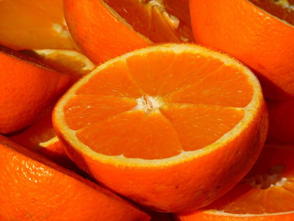 Half of orange sliced open.