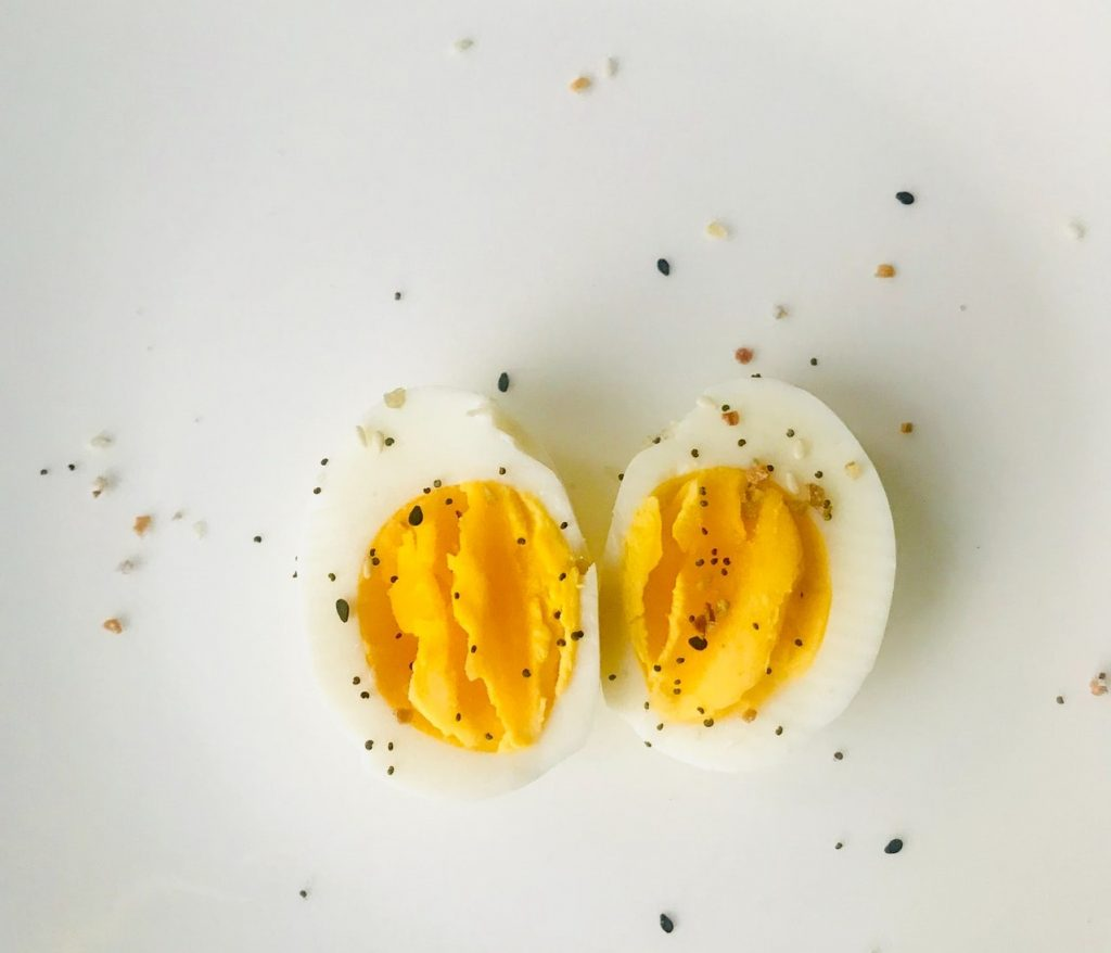 Sliced hard-boiled egg with seasoning on top.