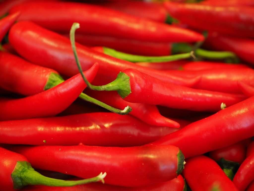 Red chili peppers in a pile.