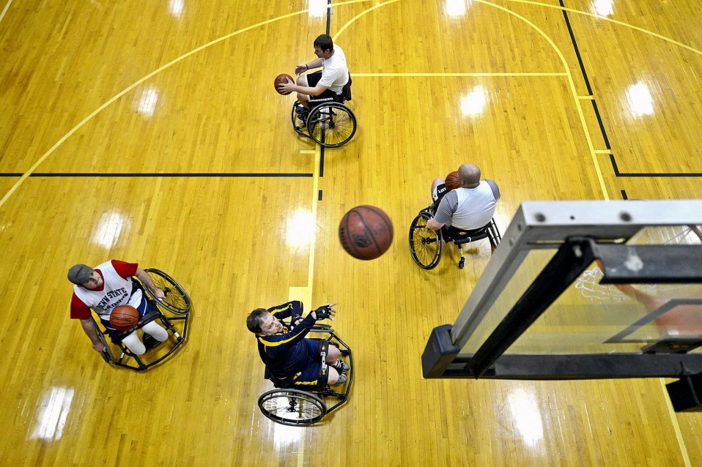 Team of wheelchair basketball players shooting hoops.