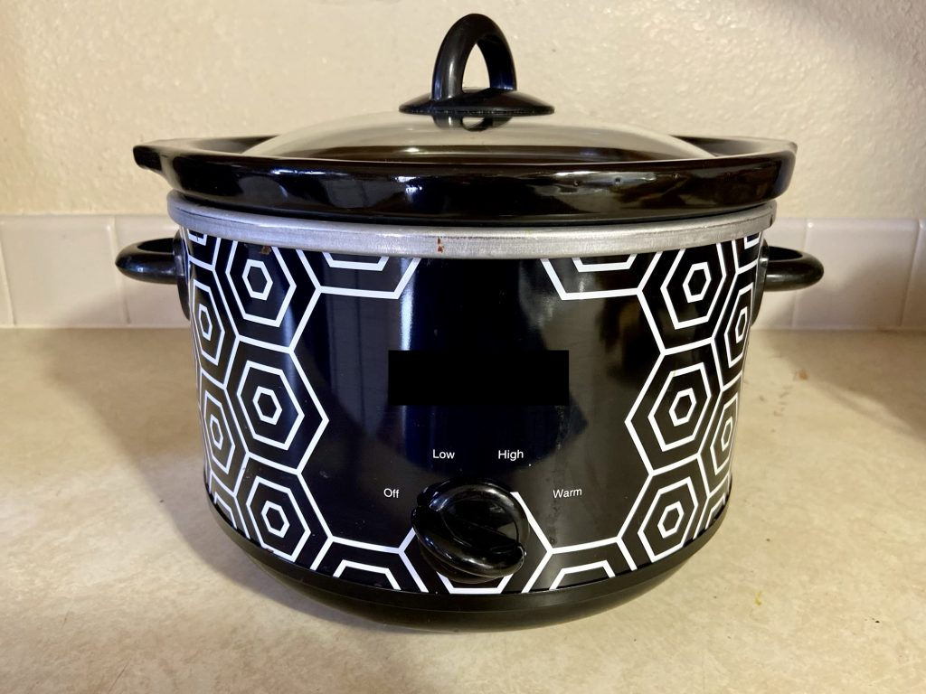 Black and white slow cooker on countertop