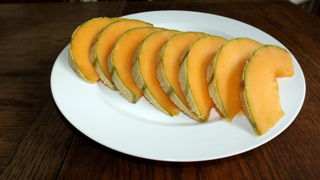 Cut fresh melon on a plate.