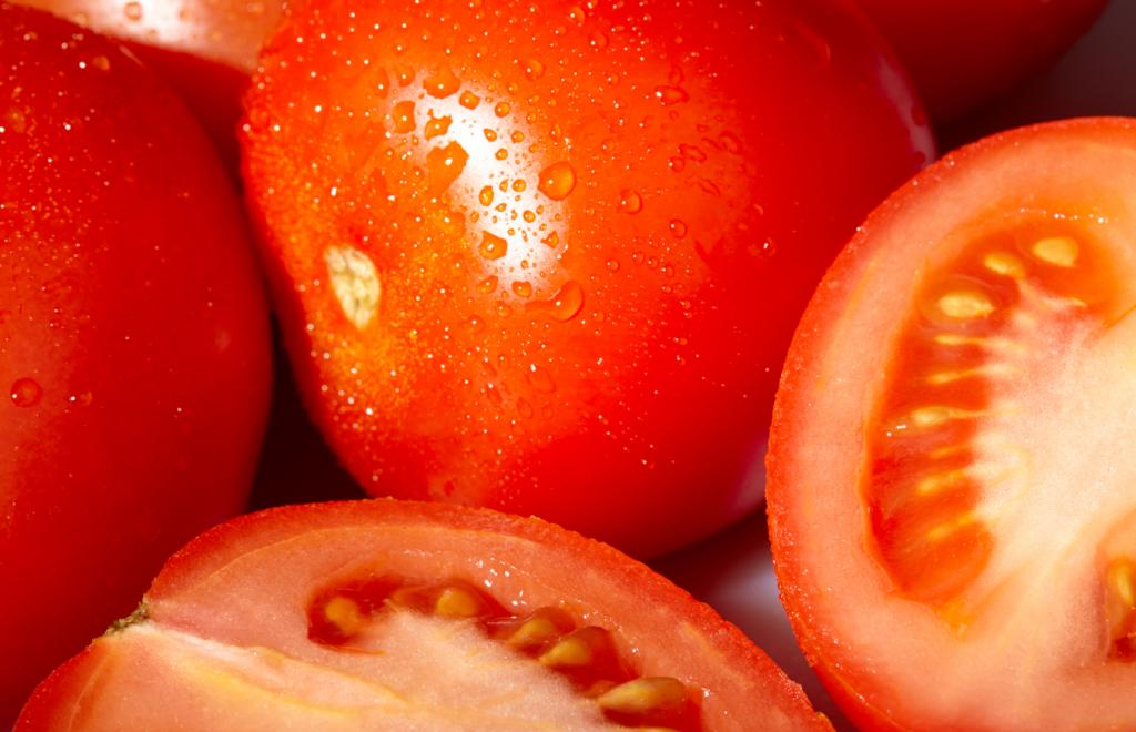 Cut roma tomatoes.