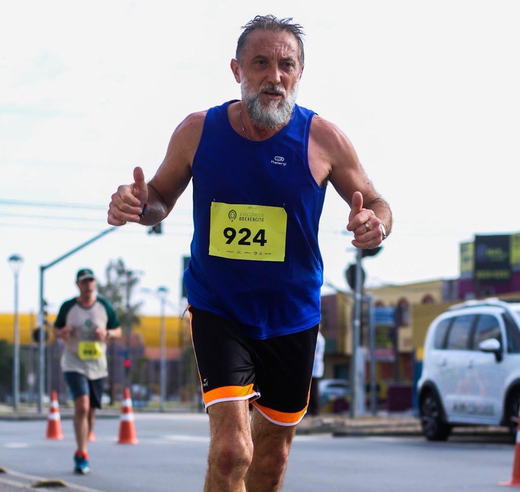 Older man running road race.