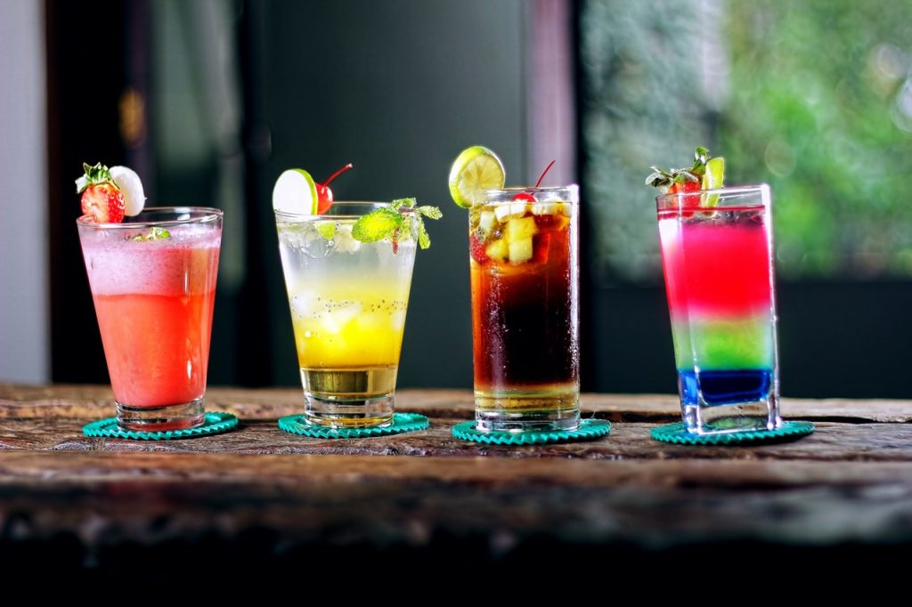 Four various mixed cocktails on a countertop