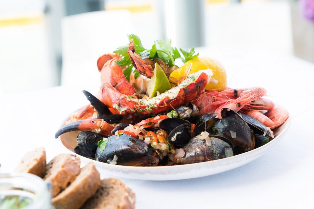 Various types of shellfish on a plate.