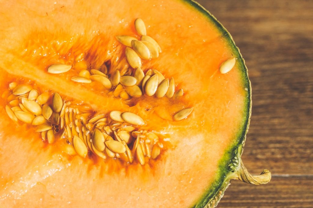 Cut cantaloupe, lengthwise, on a countertop