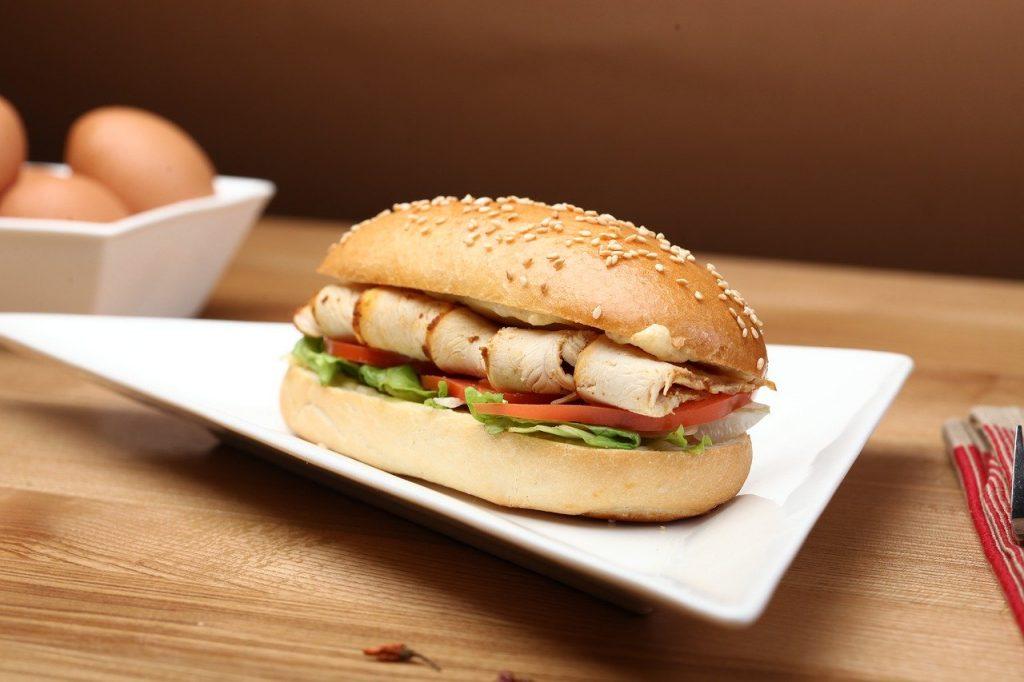 Turkey sandwich on a triangular plate.