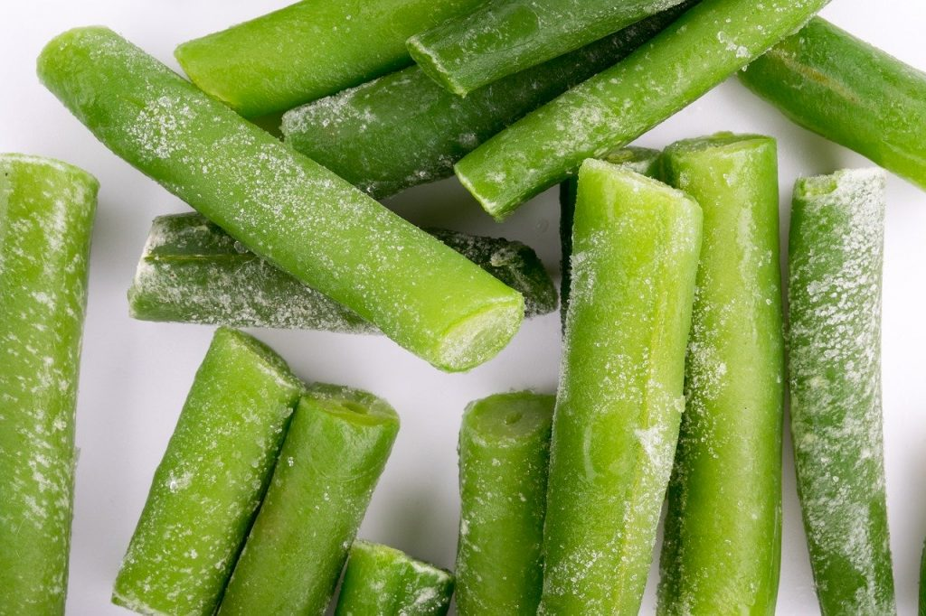 Frozen green beans on a table