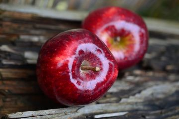 Red apples on wood table.