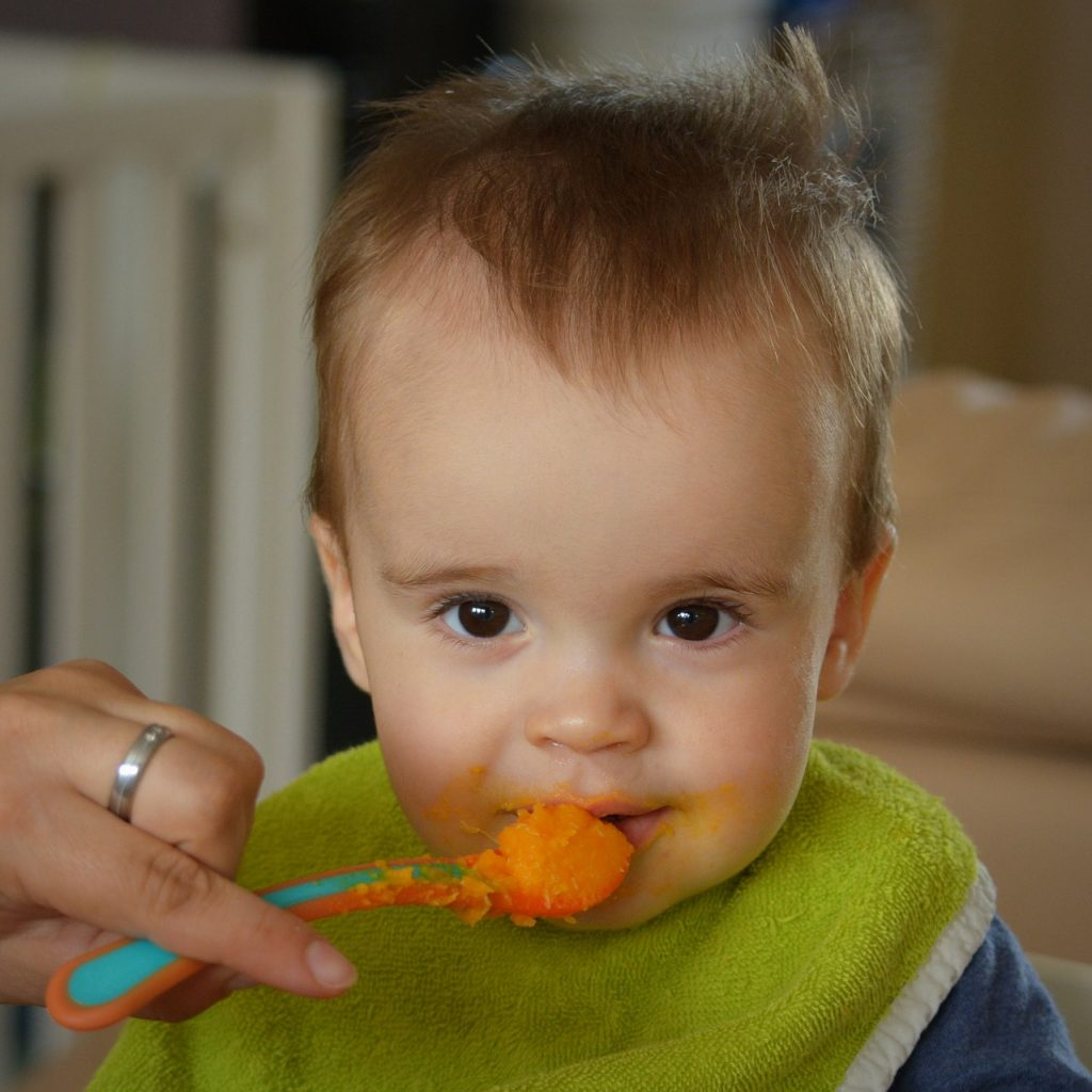 Baby being fed with spoon